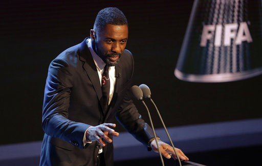 (AP Photo/Alastair Grant, FILE). FILE - In this file photo dated Monday, Oct. 23, 2017,  Actor Idris Elba speaks during The Best FIFA 2017 Awards in London. British actor Idris Elba has stoked speculation he may take over the role of James Bond when Da...