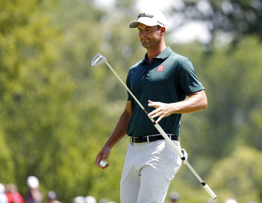 (AP Photo/Brynn Anderson). Adam Scott, of Australia, catches his putter on the first green during the third round of the PGA Championship golf tournament at Bellerive Country Club, Saturday, Aug. 11, 2018, in St. Louis.