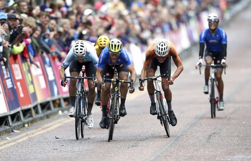 (John Walton/PA via AP). Italy's Matteo Trentin sprints to win the Men's Road Race on day eleven of the 2018 European Championships in Glasgow. Sunday Aug. 12, 2018.