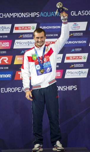 (Ian Rutherford/PA via AP). Russia's Aleksandr Bondar poses on the podium after winning gold medal in the Men's 10m Platform Final during the European Championships at the Royal Commonwealth Pool in Edinburgh, Scotland, Sunday Aug. 12, 2018.