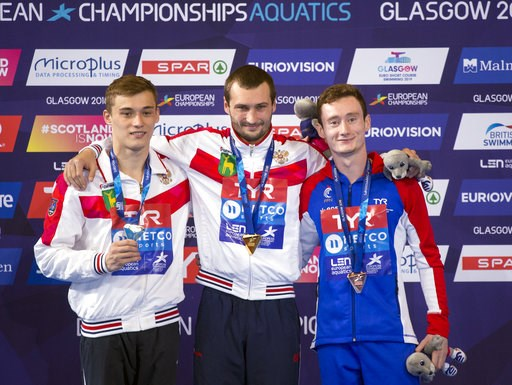 (Ian Rutherford/PA via AP). Men's 10m Platform Final medal winners, pose from left to right,  Russia's Nikita Shleikher with silver, Russia's Aleksandr Bondar with gold, and France's Benjamin Auffret with bronze, during the European Championships at th...