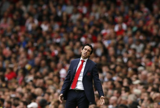 (AP Photo/Tim Ireland). Arsenal manager Unai Emery reacts during the English Premier League soccer match between Arsenal and Manchester City at the Emirates stadium in London, England, Sunday, Aug. 12, 2018.
