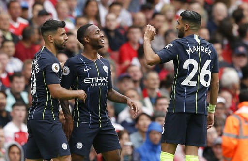 (AP Photo/Tim Ireland). Manchester City's Raheem Sterling, center, celebrates with Sergio Aguero and Riyad Mahrez, right, after scoring the opening goal during the English Premier League soccer match between Arsenal and Manchester City at the Emirates ...