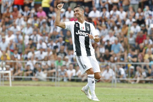 (AP Photo/Antonio Calanni). Juventus' Cristiano Ronaldo takes part in a friendly match between the Juventus A and B teams, in Villar Perosa, northern Italy, Sunday, Aug.12, 2018.