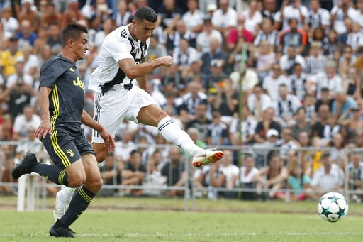 (AP Photo/Antonio Calanni). Juventus' Cristiano Ronaldo, right, controls the ball during a friendly match between the Juventus A and B teams, in Villar Perosa, northern Italy, Sunday, Aug.12, 2018.