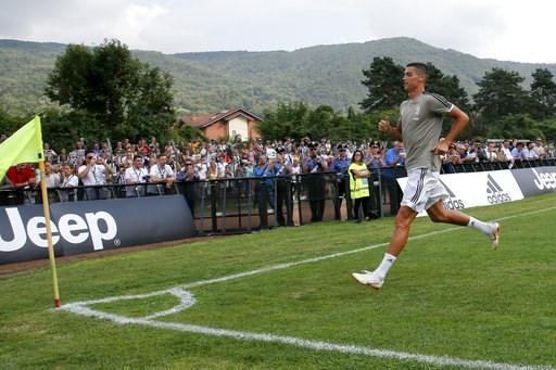 (AP Photo/Antonio Calanni). Juventus' Cristiano Ronaldo runs towards a corner of the pitch during a friendly match between the Juventus A and B teams, in Villar Perosa, northern Italy, Sunday, Aug.12, 2018.