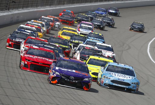 (AP Photo/Paul Sancya). Denny Hamlin (11) leads the field into Turn 1 during a NASCAR Cup Series auto race at Michigan International Speedway in Brooklyn, Mich., Sunday, Aug. 12, 2018.