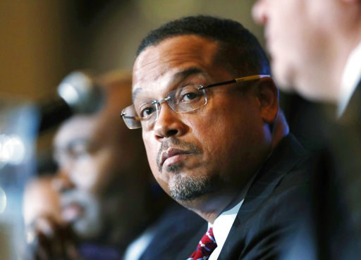 (AP Photo/David Zalubowski, File). FILE - In this Dec. 2, 2016, file photo, U.S. Rep. Keith Ellison, D-Minn., listens during a forum on the future of the Democratic Party, in Denver. On Sunday, Aug. 12, 2018, Ellison denied an allegation from an ex-gir...