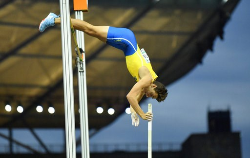 (AP Photo/Martin Meissner). Sweden's Armand Duplantis makes an attempt in the men's pole vault final at the European Athletics Championships in the Olympic stadium in Berlin, Germany, Sunday, Aug. 12, 2018.