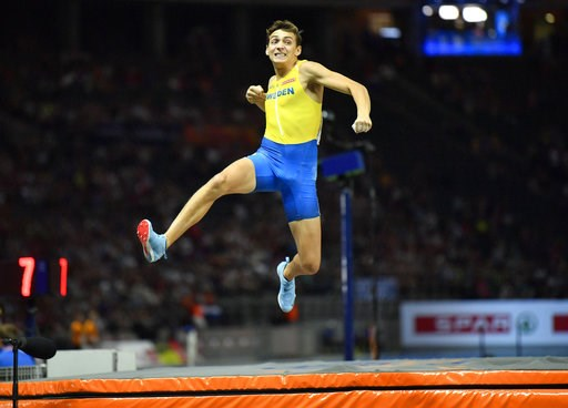 (AP Photo/Martin Meissner). Sweden's Armand Duplantis celebrates after an attempt in the men's pole vault final at the European Athletics Championships in the Olympic stadium in Berlin, Germany, Sunday, Aug. 12, 2018.