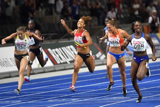 (AP Photo/Martin Meissner). Britain's Dina Asher-Smith, right, crosses the line ahead of, from left, Germany's Rebekka Haase, Switzerland's Salome Kora and Netherlands' Naomi Sedney in the women's 4x100-meter final at the European Athletics Championshi...
