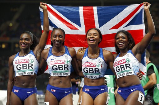 (AP Photo/Michael Sohn). From left, Britain's gold medal winner Dina Asher-Smith, Bianca Williams, Imani Lansiquot and Asha Philip pose for the photographers after the women's 4 x 100 meter relay final race at the European Athletics Championships in Be...