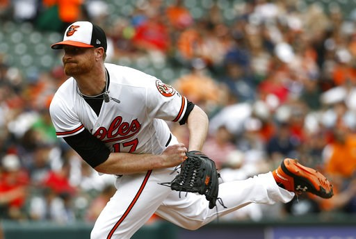 (AP Photo/Patrick Semansky). Baltimore Orioles starting pitcher Alex Cobb follows through on a pitch to the Boston Red Sox in the second inning of a baseball game, Sunday, Aug. 12, 2018, in Baltimore.