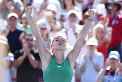 (Paul Chiasson/The Canadian Press via AP). Simona Halep of Romania reacts after defeating Sloane Stephens of the United States to win the final of the Rogers Cup tennis tournament Sunday, Aug. 12, 2018 in Montreal.