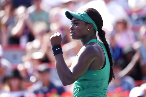 (Paul Chiasson/The Canadian Press via AP). Sloane Stephens of the United States celebrates winning the second set against Simona Halep of Romania during the final of the Rogers Cup tennis tournament Sunday, Aug. 12, 2018 in Montreal.
