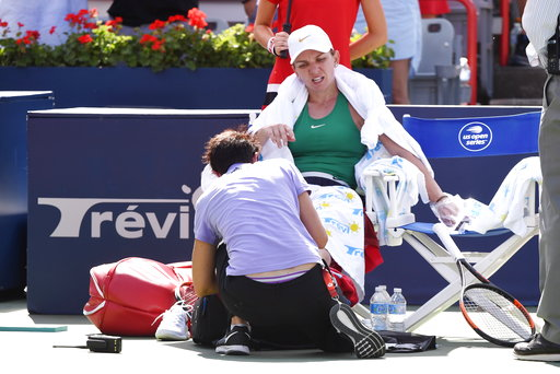 (Paul Chiasson/The Canadian Press via AP). Simona Halep, of Romania, gets medical attention between sets against Sloane Stephens, of the United States, during the final of the Rogers Cup women's tennis tournament Sunday, Aug. 12, 2018, in Montreal.