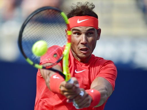 (Frank Gunn/The Canadian Press via AP). Rafael Nadal of Spain returns to Stefanos Tsitsipas of Greece during championships men's finals Rogers Cup tennis action in Toronto on Sunday, Aug. 12, 2018 in Montreal.