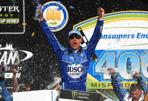 (AP Photo/Paul Sancya). Kevin Harvick celebrates his victory after a NASCAR Cup Series auto race at Michigan International Speedway in Brooklyn, Mich., Sunday, Aug. 12, 2018.