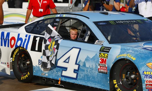 (AP Photo/Paul Sancya). Kevin Harvick's son, Keelan, rides into Winner's Circle with his father after a NASCAR Cup Series auto race at Michigan International Speedway in Brooklyn, Mich., Sunday, Aug. 12, 2018.