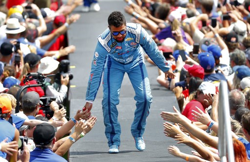 (AP Photo/Paul Sancya). Bubba Wallace greets fans before a NASCAR Cup Series auto race at Michigan International Speedway in Brooklyn, Mich., Sunday, Aug. 12, 2018.