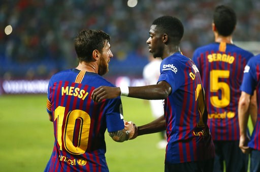 (AP Photo/Mosa'ab Elshamy). Barcelona's Ousmane Dembele celebrates with Lionel Messi, left, after scoring his side's second goal during the Spanish Super Cup soccer match between Sevilla and Barcelona in Tangier, Morocco, Sunday, Aug. 12, 2018.