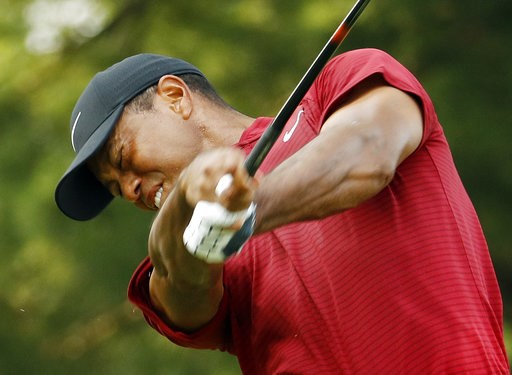 (AP Photo/Charlie Riedel). Tiger Woods hits from the 15th tee during the final round of the PGA Championship golf tournament at Bellerive Country Club, Sunday, Aug. 12, 2018, in St. Louis.