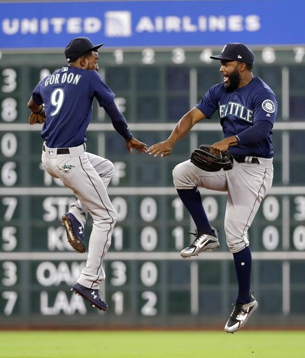 (AP Photo/David J. Phillip). Seattle Mariners' Dee Gordon (9) and Denard Span celebrate after a baseball game against the Houston Astros Sunday, Aug. 12, 2018, in Houston. The Mariners won 4-3 in 10 innings.