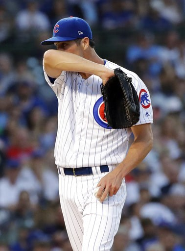 (AP Photo/Nam Y. Huh). Chicago Cubs starting pitcher Cole Hamels wipes his face during the second inning of a baseball game against the Washington Nationals, Sunday, Aug. 12, 2018, in Chicago.