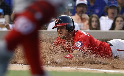 (AP Photo/Nam Y. Huh). Washington Nationals' Ryan Zimmerman scores on a sacrifice fly by Mark Reynolds during the second inning of a baseball game against the Chicago Cubs, Sunday, Aug. 12, 2018, in Chicago.