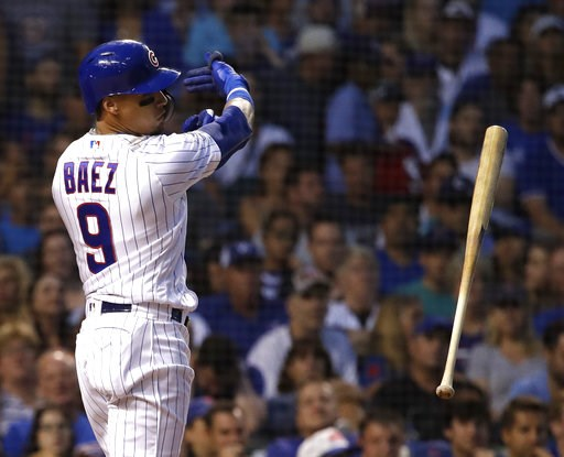 (AP Photo/Nam Y. Huh). Chicago Cubs' Javier Baez throws his bat after striking out swinging during the third inning of a baseball game against the Washington Nationals, Sunday, Aug. 12, 2018, in Chicago.