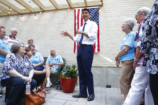 (AP Photo/John Minchillo). Hamilton County Clerk of Courts Aftab Pureval speaks at a fundraising event for his 1st House District campaign challenge to veteran Republican Rep. Steve Chabot at a supporters home, Friday, June 15, 2018, in Maineville, Ohi...