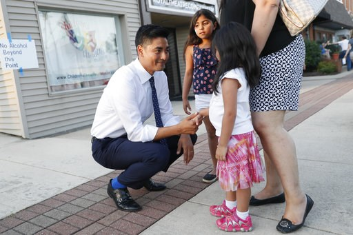 (AP Photo/John Minchillo). Hamilton County Clerk of Courts Aftab Pureval greets constituents and their children as he campaigns for his 1st House District challenge against veteran Republican Rep. Steve Chabot at a music festival, Friday, June 15, 2018...