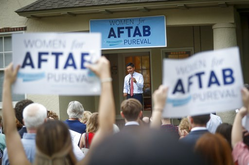 "(AP Photo/John Minchillo, File). In this June 13, 2018, file photo, Hamilton County Clerk of Courts Aftab Pureval speaks during the ""Women for Aftab"" advocacy group kickoff event in support of Pureval's 1st House District challenge to veteran Republica..."