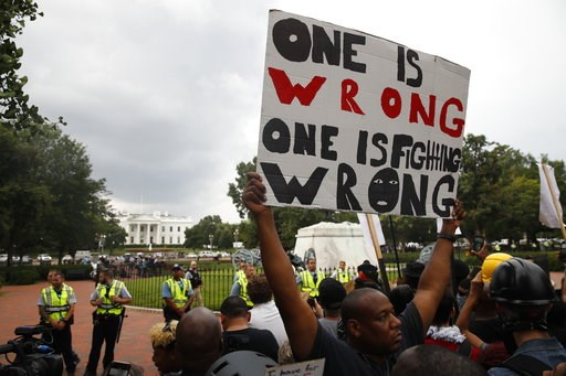 """(AP Photo/Jacquelyn Martin). Demonstrators march near the White House on the one year anniversary of the Charlottesville """"Unite the Right"""" rally, Sunday, Aug. 12, 2018, in Washington."""