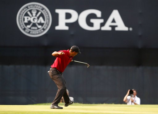 (AP Photo/Jeff Roberson). Tiger Woods celebrates his birdie putt on the 18th green during the final round of the PGA Championship golf tournament at Bellerive Country Club, Sunday, Aug. 12, 2018, in St. Louis.