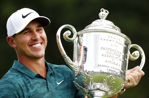 (AP Photo/Brynn Anderson). Brooks Koepka holds the Wanamaker Trophy after he won the PGA Championship golf tournament at Bellerive Country Club, Sunday, Aug. 12, 2018, in St. Louis.