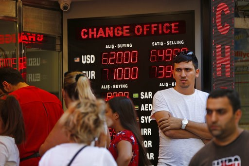 (AP Photo/Lefteris Pitarakis). People line up at a currency exchange shop in Istanbul, Tuesday, Aug. 14, 2018.The Turkish lira has nosedived in value in the past week over concerns about Erdogan's economic policies and after the United States slapped s...