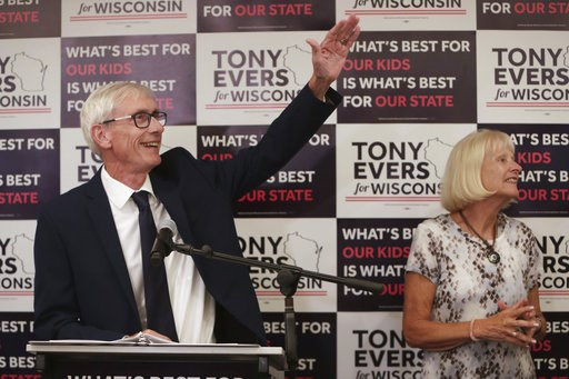 (Amber Arnold/Wisconsin State Journal via AP). Tony Evers, with his wife, Kathy, speaks after his win in Wisconsin's Democratic gubernatorial primary election during an event at Best Western Premier Park Hotel in Madison, Wis., Tuesday, Aug. 14, 2018.