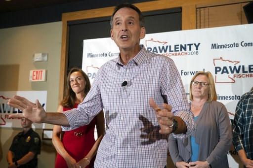 (Glen Stubbe/Star Tribune via AP). Tim Pawlenty stands with his wife, Mary, background left, and running mate Michelle Fischbach as he concedes his run for governor at his election night gathering at Granite City Food and Brewery, Tuesday, Aug. 14, 201...