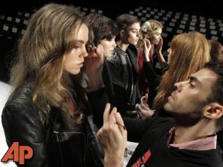 Models have their make-up finalized before the J. Mendel Fall 2012 collection is modeled during Fashion Week, in New York. (AP Photo/Richard Drew, file)