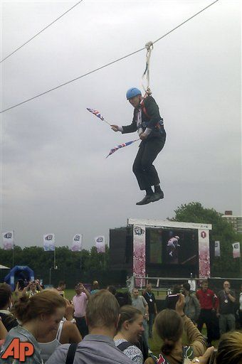 Boris Johnson, the mayor of London, dangling in midair above the crowds at an open-air viewing site at east London's Victoria Park, Aug. 1, 2012. (AP Photo/Lee Medcalf)