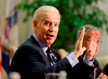 Steve Helber). Vice President Joe Biden gestures during a round table