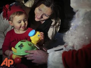 Sandy Claus delivers toys to storm-stricken kids