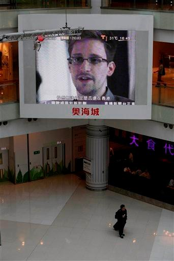 (AP Photo/Kin Cheung). A TV screen shows the news of Edward Snowden, a former CIA employee who leaked top-secret documents about sweeping U.S. surveillance programs, at a shopping mall in Hong Kong Friday, June 21, 2013.