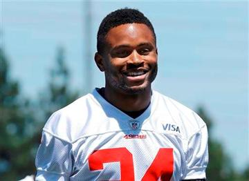 (AP Photo/Jeff Chiu, File). FILE - In this May 22, 2013, file photo, San Francisco 49ers cornerback Nnamdi Asomugha smiles for photographers as he leaves the practice field at an NFL football training camp in Santa Clara, Calif.