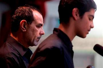 (AP Photo/Gregory Bull, File). FILE - In this March 27, 2012 file photo, Kassim Alhimidi, left, looks on alongside his son, Mohammed Alhimidi, during a memorial for his wife, Shaima Alawadi at a mosque in Lakeside, Calif.