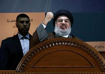 (AP Photo/Hussein Malla, File). FILE - In this August 2, 2013, file photo, Hezbollah leader Sheik Hassan Nasrallah speaks during a rally to mark Jerusalem day or Al-Quds day, in the southern suburb of Beirut, Lebanon.