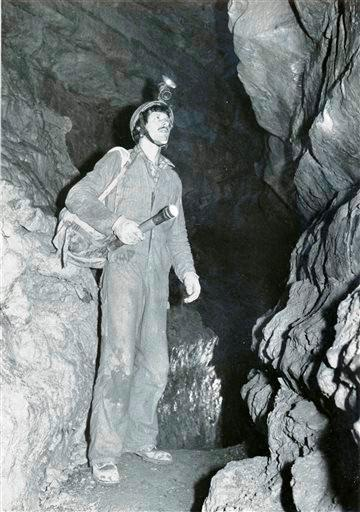 (AP Photo/Courtesy John Ackerman). In this 1980's photo provided by John Ackerman, Ackerman stands inside his Spring Valley Caverns near Spring Valley, Minn.