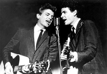 (AP Photo, File). FILE - This July 31, 1964 file photo shows The Everly Brothers, Don and Phil, performing on stage.