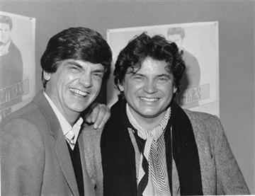 (AP Photo/Ray Stubblebine, File). FILE - In this Jan. 4, 1984 file photo, Phil, left, and Don Everly, of the Everly Brothers joke around for photographers in New York City.